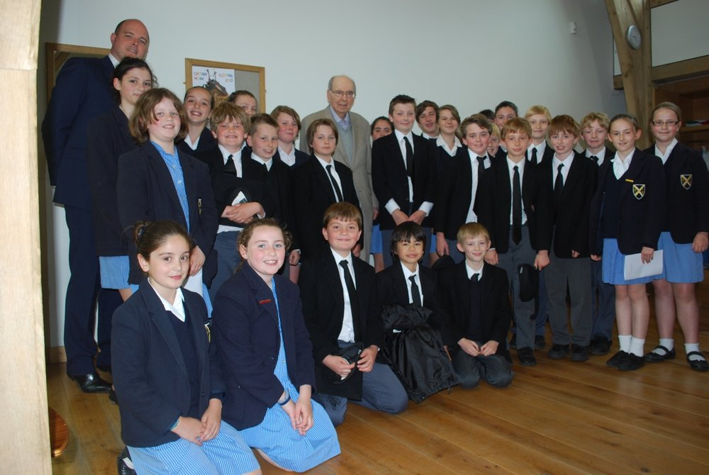 Joubert pictured with the choristers of June 2013, following the first performance of Missa Wellensis