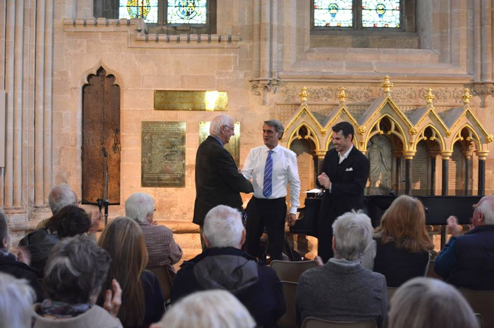Composer Paul Drayton congratulates members of the Vicars Choral  Edward Goater  and Christopher Sheldrake following their performance of his song cycle during Monday's lunchtime concert.
