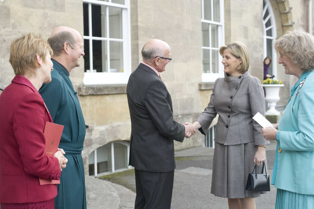 Iain Ball [centre] welcomes HRH The Countess of Wessex to Wells Cathedral School on her first official visit in 2007