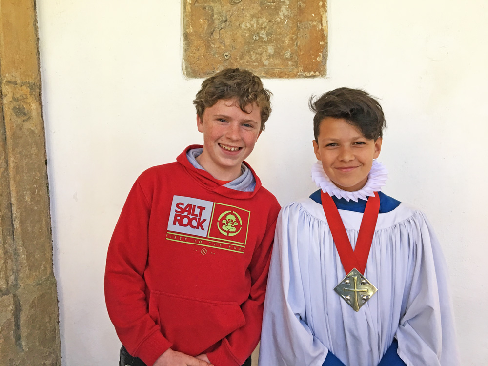 Outgoing Head Chorister Taylor (left) hands on the baton to his successor, Xavier