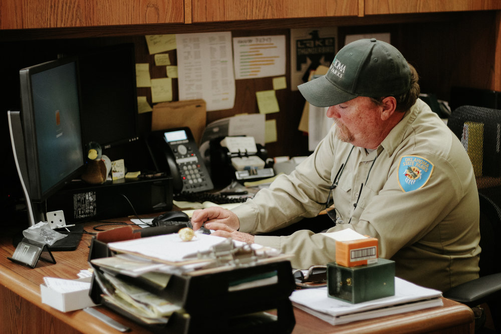 Sherman works at his desk in the Lake Thunderbird State Park offices.
