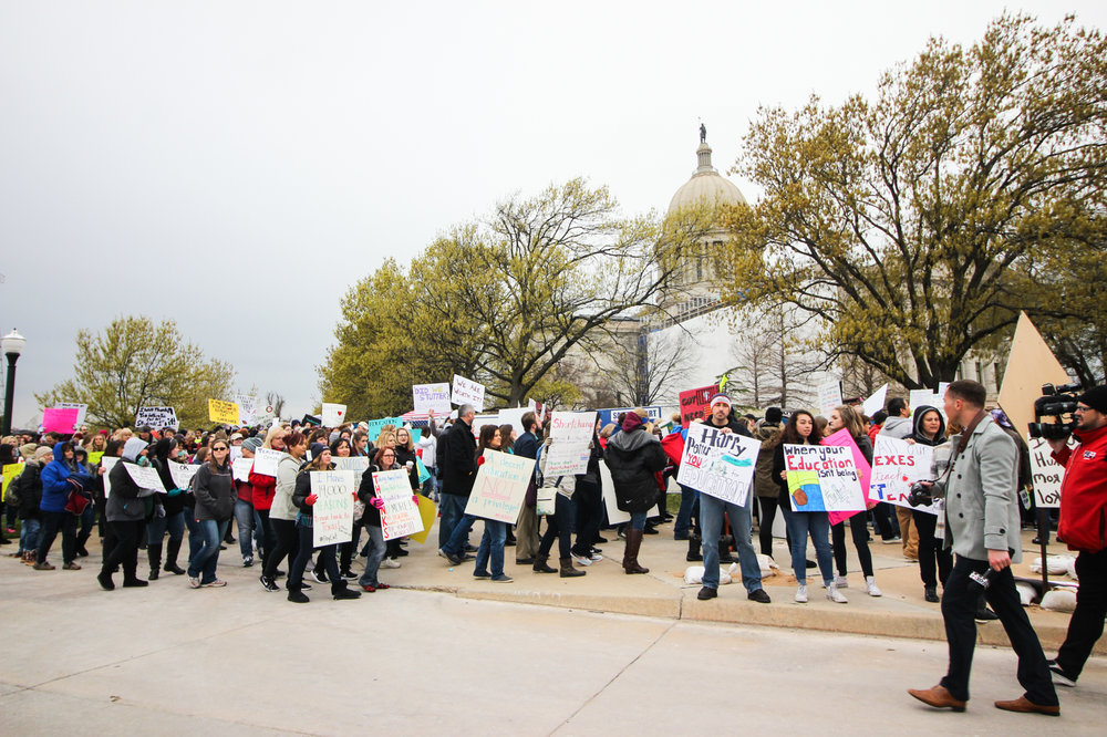 Demonstrators march around the Oklahoma State Capitol.