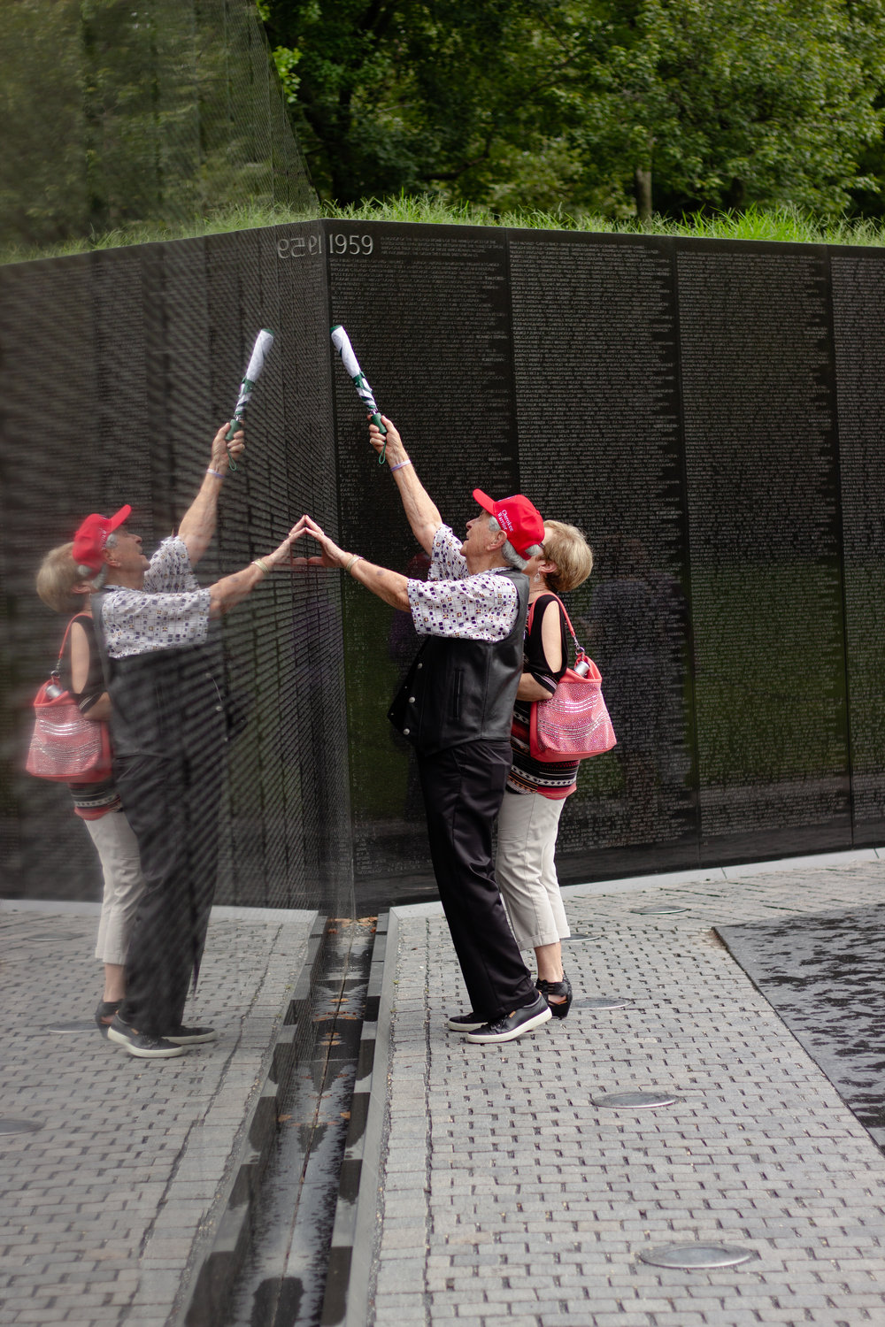 John Cockrum finds the name of his former student on the wall of the Vietnam Veterans Memorial.