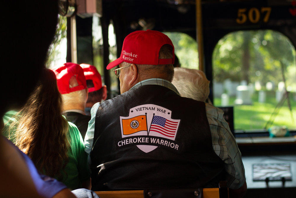 The veterans of the 2018 Cherokee Warrior Flight ride a tour bus at Arlington National Cemetery.