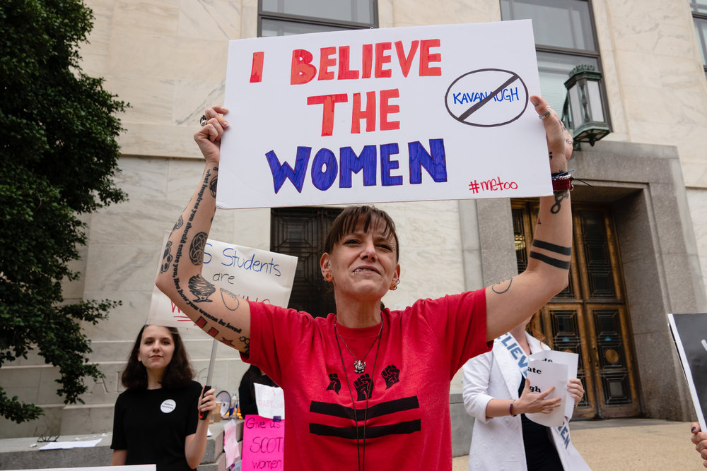 """Protesters chant, """"We believe her,"""" outside the Dirksen Senate Office Building, where the Senate Judiciary Committee held its hearing."""