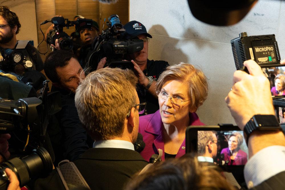 Members of the press surround Senator Elizabeth Warren of Massachusetts in the Hart Senate Office Building.