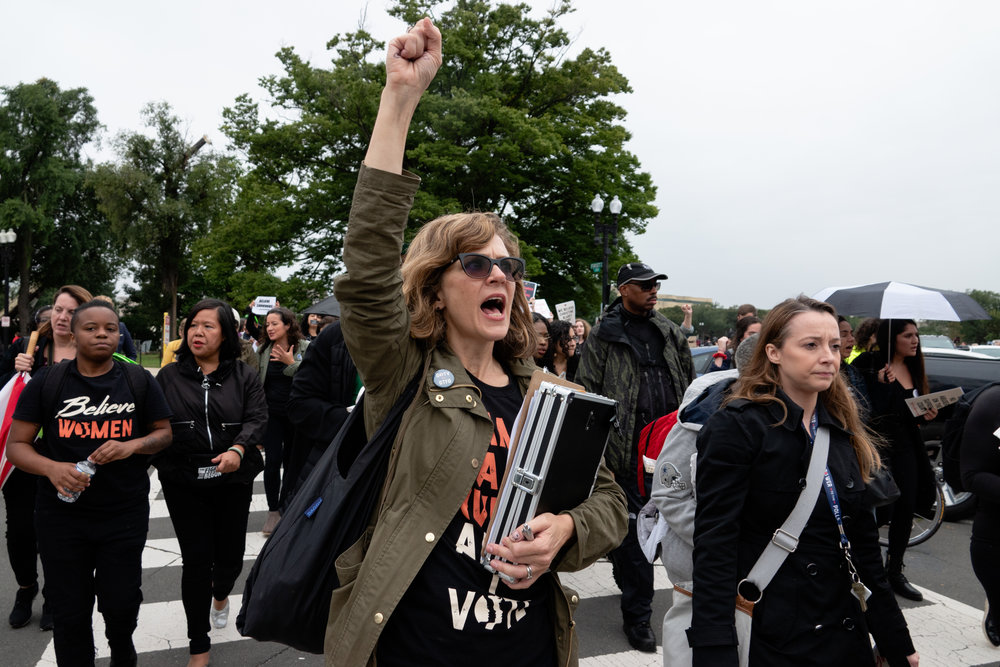 Protesters march from the Capitol Building to the National Mall.