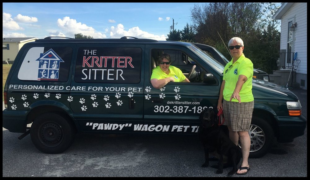 Meet The Kritter Sitter's Co-Owners! Karen (standing) and Mandy (in vehicle).