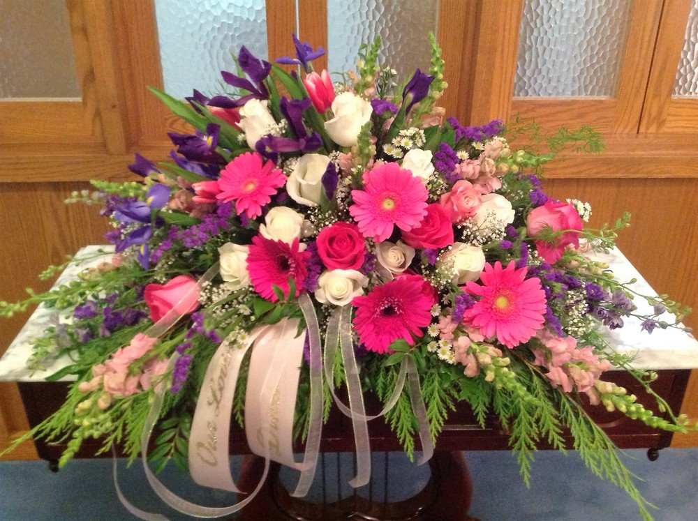 #11 Bright pink gerbera, blue iris casket spray