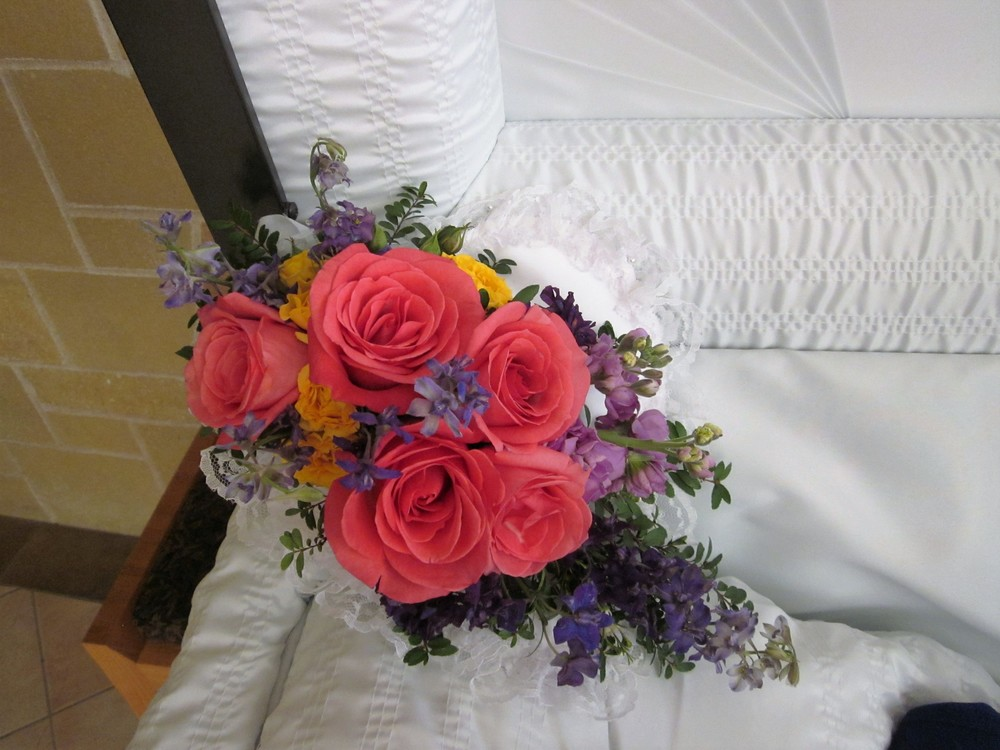 #9 Bright coral roses casket accent