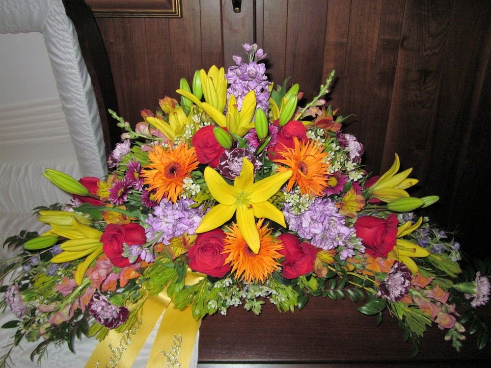 #17 Large bright colored, multi floral casket spray