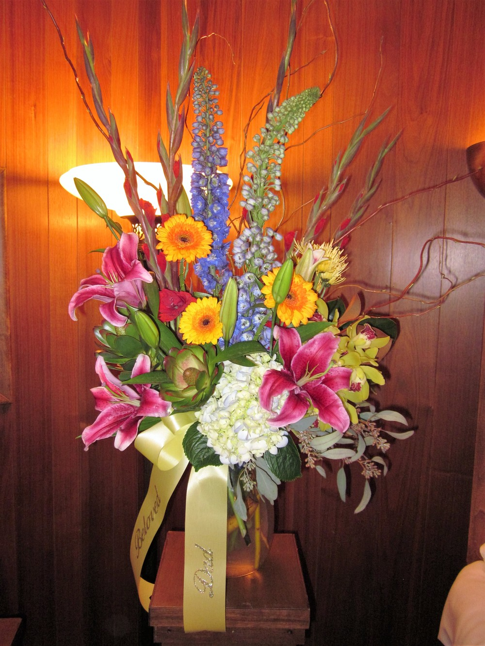 #16 large vase arrangement of bright colored stargazers, gerbera and glads