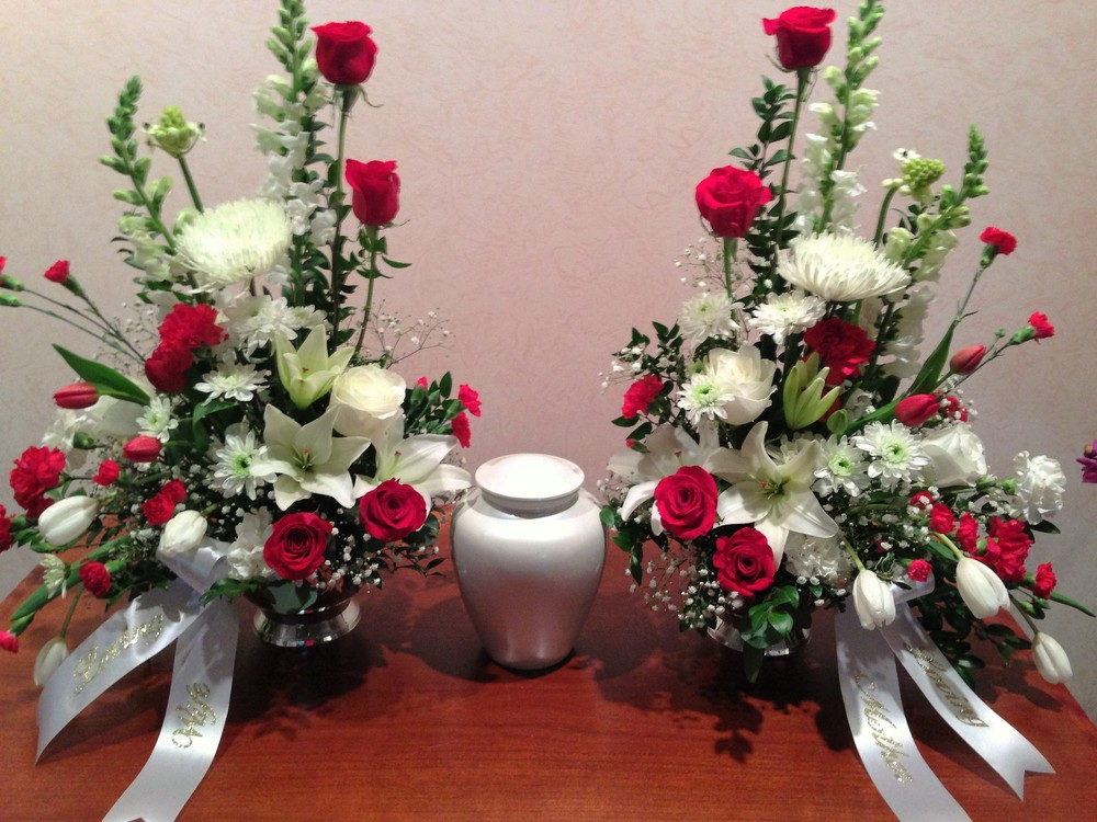 #22 urn surround in red and white with two side arrangements