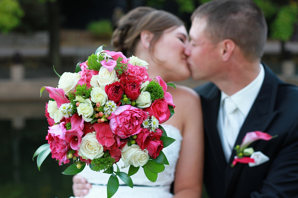 3. Hot pink calla and garden roses