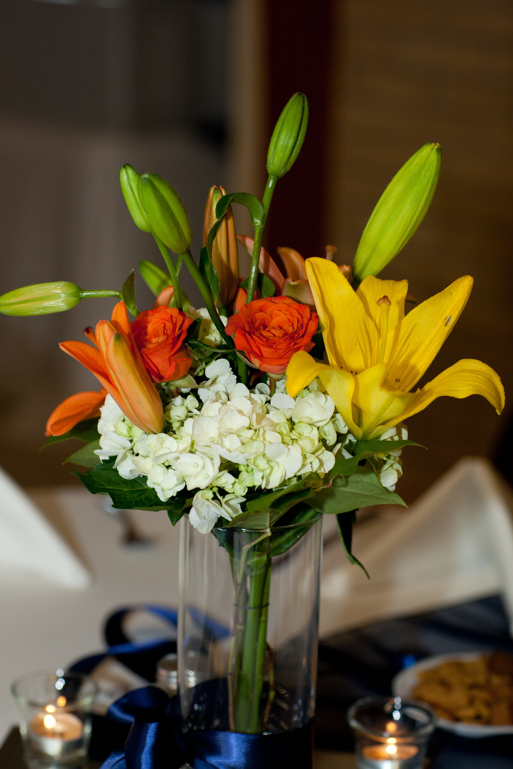 11. Orange and yellow lily with hydrangea centerpiece
