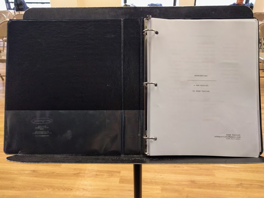 A music stand with the score of Abomination! A New Musical sitting on it in Pearl, Studios NYC.