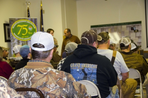 Adult guardians and family members listen to a pre-hunt presentation by members of the S.C. Coon Hunters Association.