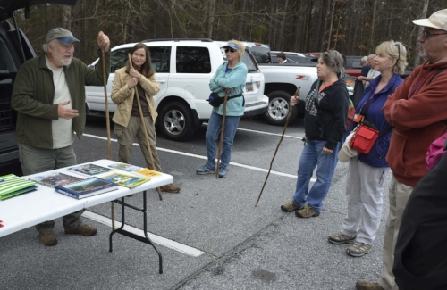 "Dennis Chastain prepares to lead a Clemson University ""OLLI"" group on a trek to see blooming Oconee Bells."