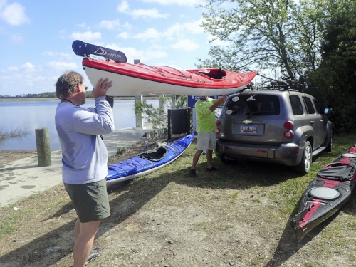 Helping load the boats (note unflattering waistline - aka the editorial bulge).  photo by Nancy Stills, Sun City Hilton Head Kayak Club