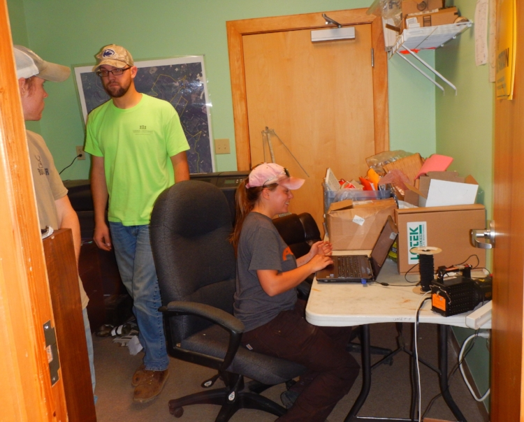 In  a tiny office in the Webb Center crowded with equipment, Kyle Zinn, Ryan Klinedinst and Alaina Gerrits  gather around a laptop computer to review data collected over the previous week. The three are looking forward to long careers as wildlife professionals, and their work on the SCDNR wild turkey research project will provide valuable experience towards their career goals.