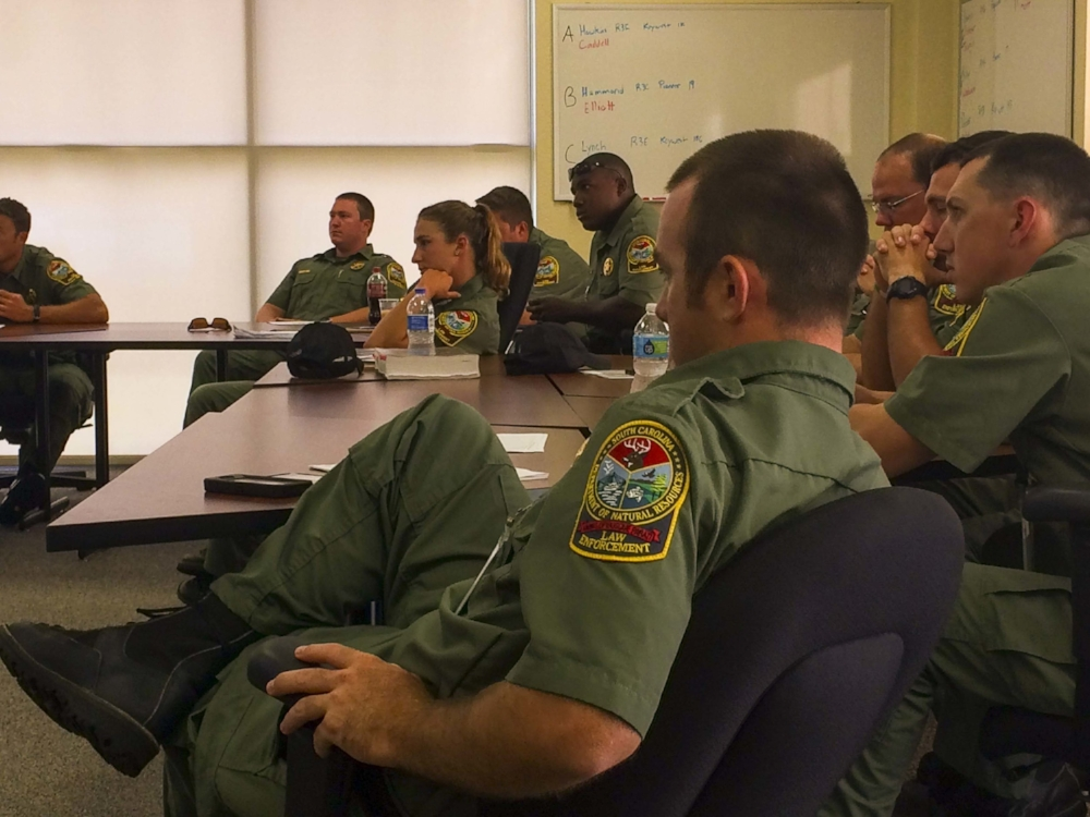 New SCDNR officers listen intently during their last day of classroom instruction before beginning their new careers.