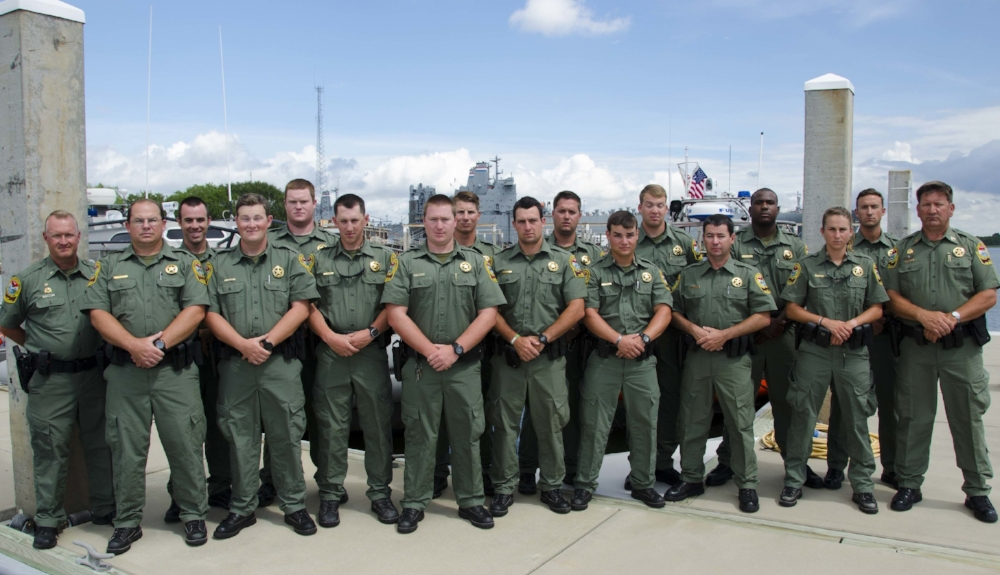 Left to right: Lead Training Supervisor Lt. R. Monnet; Pfc. J. Dozier; Pfc. J. Scogin; Pfc. J. Hammond; Pfc. B. Woodward; Pfc. D. Sherbert; Pfc. J. Riley; Pfc. A Pritcher; Pfc. A. Miller; Pfc. H. Mize; Pfc. G. Caddell; Pfc. J. Hawkins; Pfc. B. Elliott; Pfc. A. D. Ruff; Pfc. T.M. Donahue; Pfc. W. Lynch; Training Supervisor H. McClellan.