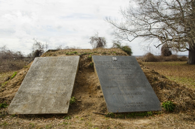 These monuments at the base of the mound provide detail about its role as the location for a Revolutionary War fort.