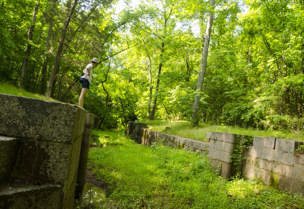 Checking out the remnants of the locks at Landsford Canal State Park. The canal system was built in the early 1800s to route boats around the shallow, rocky shoals of the Catawba River in the heart of South Carolina's Olde English District tourism region. SCDNR photo by David Lucas.