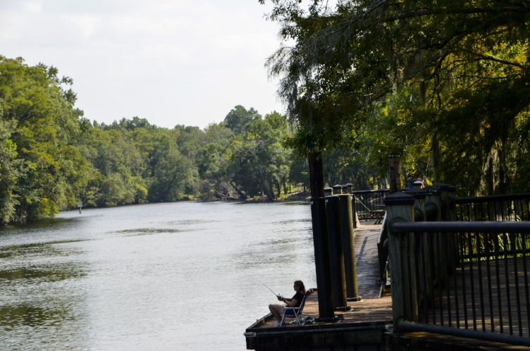 A relaxing afternoon of fishing from the scenic Waccamaw Riverwalk is a favorite low-key getaway for Conway locals. [SCDNR image by David Lucas -- see complete photo gallery at the end of the article.]