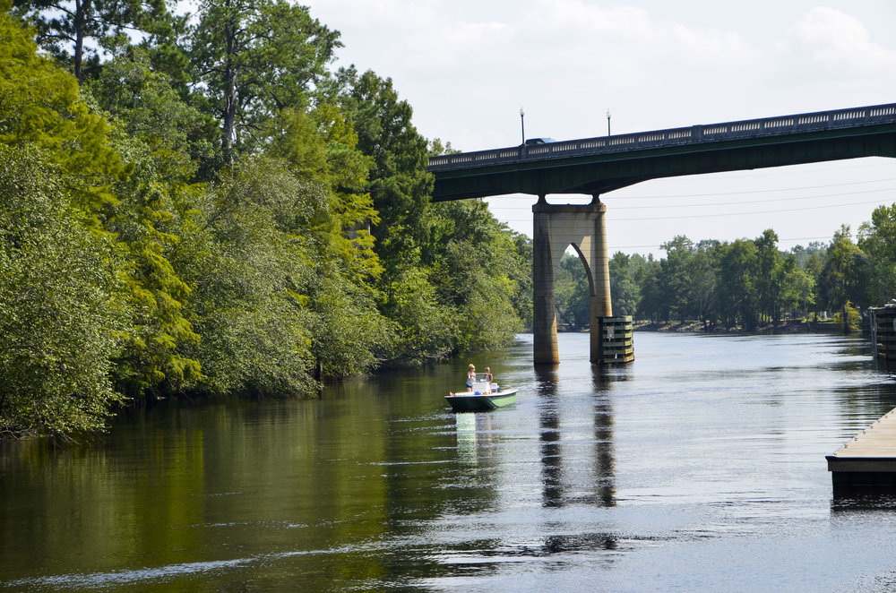 The highway 501 bridge crosses the river here, and boats can tie up at the City Marina or at day-use docks along the Riverwalk.