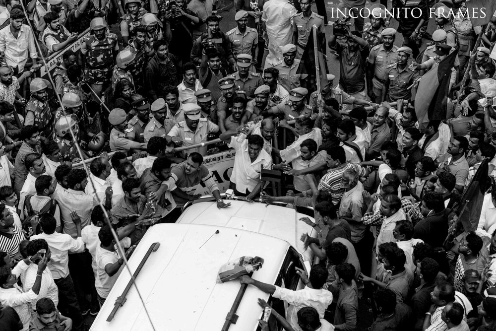 Angry crowed asking the car driver which assisted MDMK chief Vaiko's car to move back as it tried to enter the restricted area.