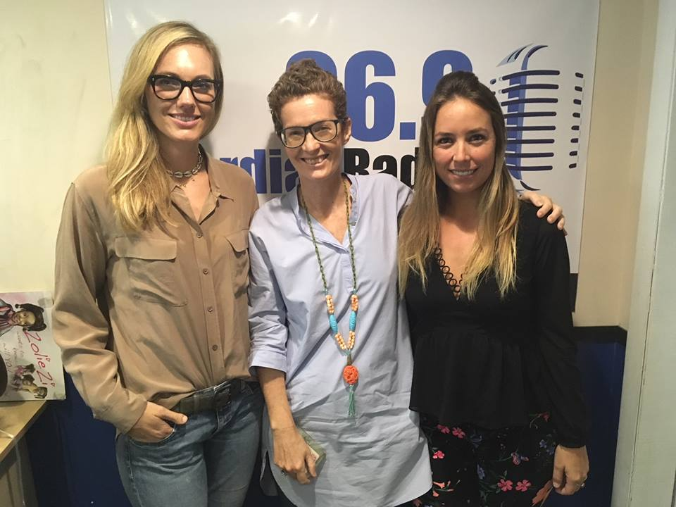 """It's an all-female cast in the """"Blank Canvas"""" studio this week. Joining your regular host, NAGB Director Amanda Coulson, are Lauren Holowesko, Director of The Island House boutique hotel on the West End of New Providence (left), and Natascha Vasquez (right), the Creative Arts Programming Manager at The Current, studio and gallery at Bahamar. Natascha is also a painter who is having her first solo show at home in The Bahamas at The Island House this Friday, December 1st.  Lauren comes from a family that has had an impact on the arts in The Bahamas for several decades—her aunt Diane Holowesko envisioned the BNT's Wine and Art event—and she continues a family tradition of arts support in her vision for The Island House, which aims to be a cultural experience as much as a restful haven for holiday makers and locals alike. Lauren speaks to the wide variety of programming scheduled at the Island House, including a film series—curated by Bahamian filmmaker Kareem Mortimer—regular music nights and, of course, the visual arts.  Natascha is one of the lucky artists to be showcased in a temporary exhibition at The Island House and she shares her experience of coming home to be a practicing artist and also her work at The Current. Both guests speak to their desire to expand the notion of what is """"Bahamian"""" through their unique lens.  Don't miss Natascha's show at The Island House this Friday December 1st at 6 p.m. The """"Blank Canvas,"""" airs every Wednesday at 6:30 p.m, on Guardian talk radio 96.9 FM."""