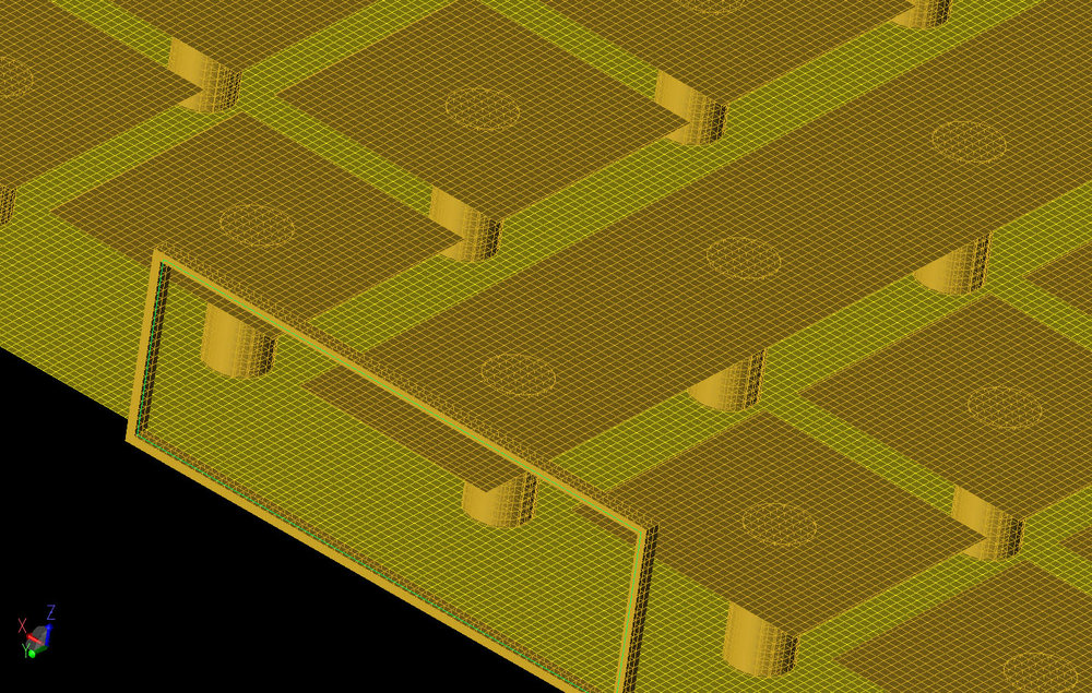 Figure 3 A three-dimensional view of the XFdtd mesh of the device near one of the ports. The box and substrate have been removed in this view to show the interior detail.