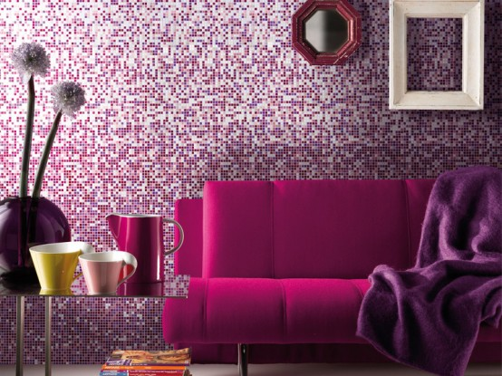 Glamorous-living-room-design-with-pink-sofa-and-purple-blanket-and-purple-mosaic-wall-ideas-matching-glass-accessories-on-glass-table-by-Mosaico