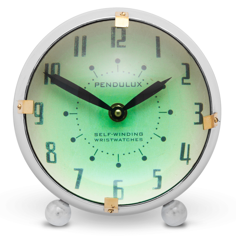 ORBIT TABLE CLOCK - $210.00