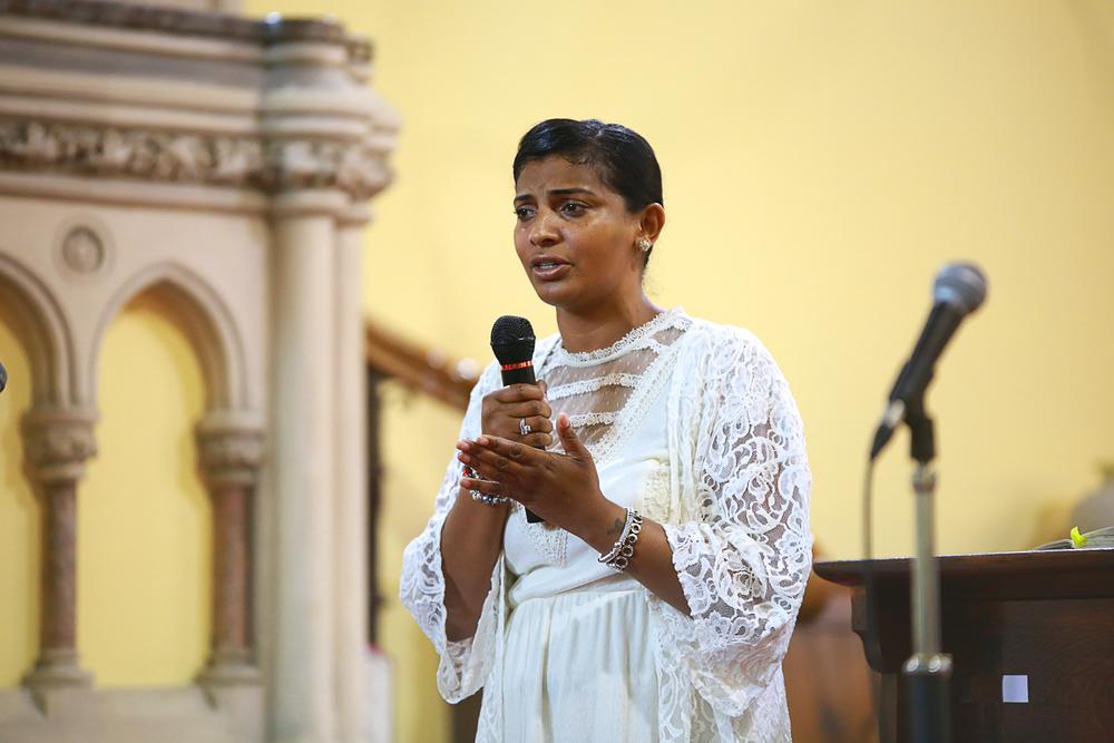 Melinda preaching at COGIC UK