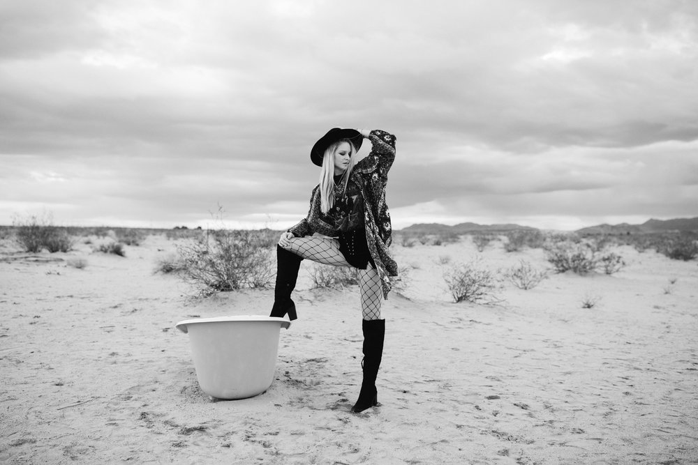 B/W photo of girl in the desert and a bath tub.