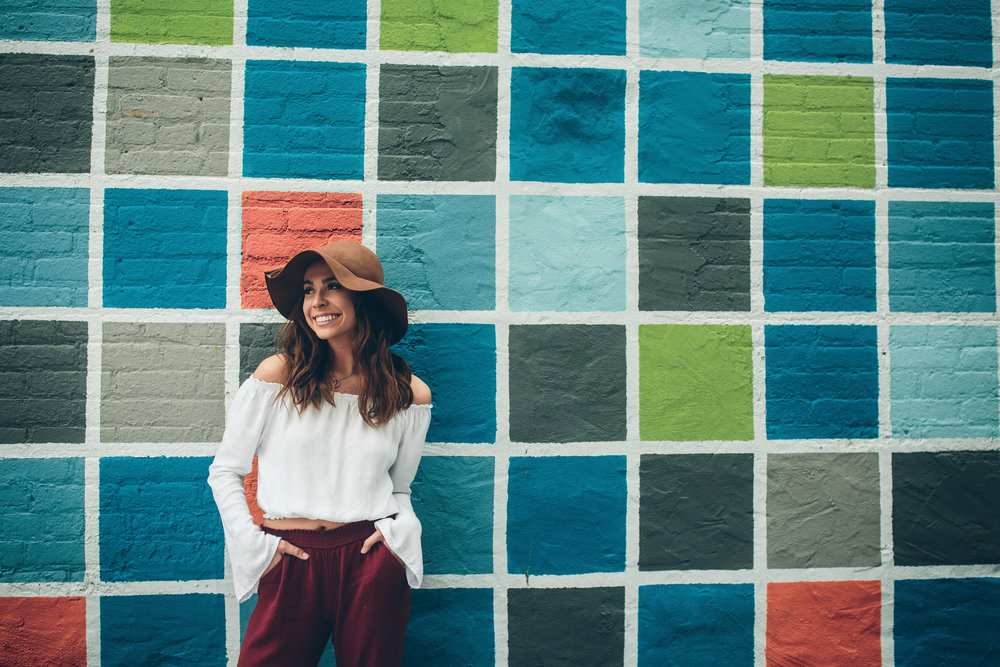 Colorful, geometric wall senior picture taken on the east side of Madison, WI.