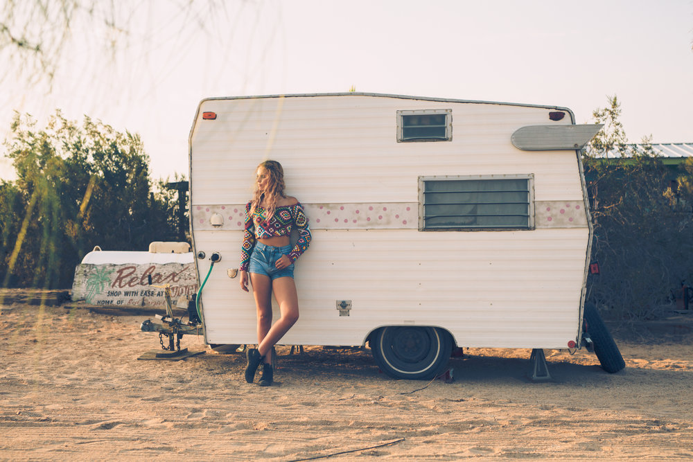Vintage camper senior picture in the California desert.