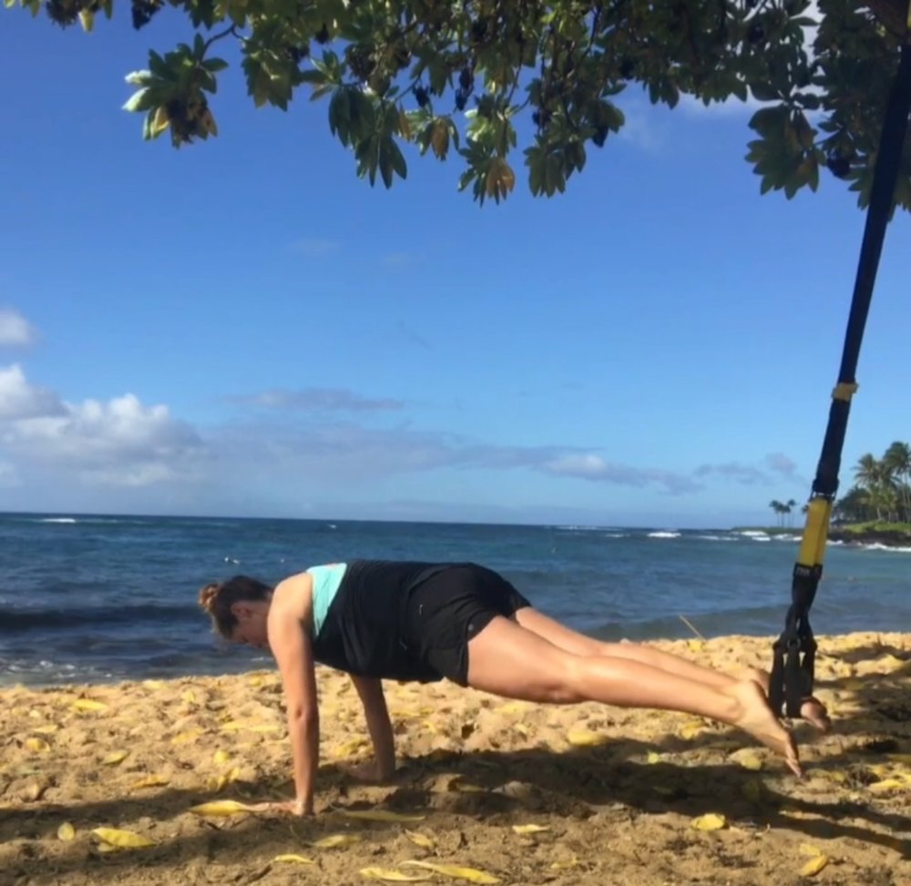 28 weeks - using TRX bands on the sand to challenge my stability even more!