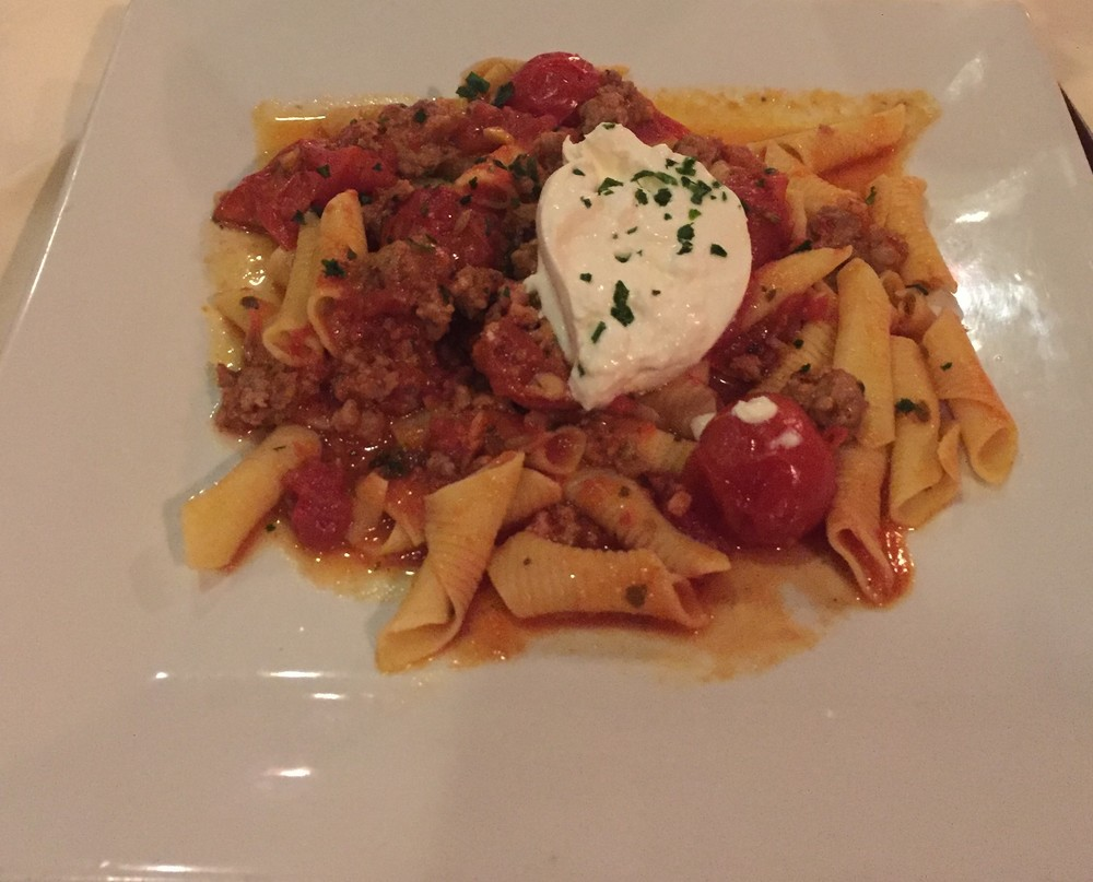 Homemade Garganelli with spicy Italian sausage, roasted tomatoes and Burratta