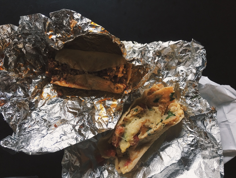 The chorizo, egg, and cheese taco (L), and the migas taco (R), ready for eating in the neighbouring Radio Coffee. Small businesses on the same lot often partner in Austin, to promote themselves simultaneously.