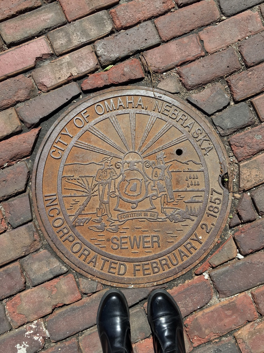 Lia took a photo of the sewer cover for me. One of my weird sources of pleasure is cities with cool manhole covers. Omaha's was pretty fun; Charleston, SC's is two cannons and a palm tree; and Lia knows one of the reasons I love her is because her hometown has the only triangular manhole covers in the country.