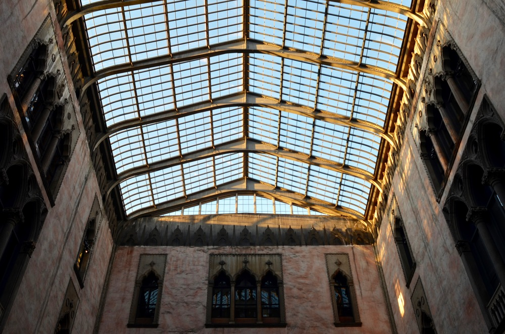 Looking up: the glass ceiling that protects the courtyard from the elements.