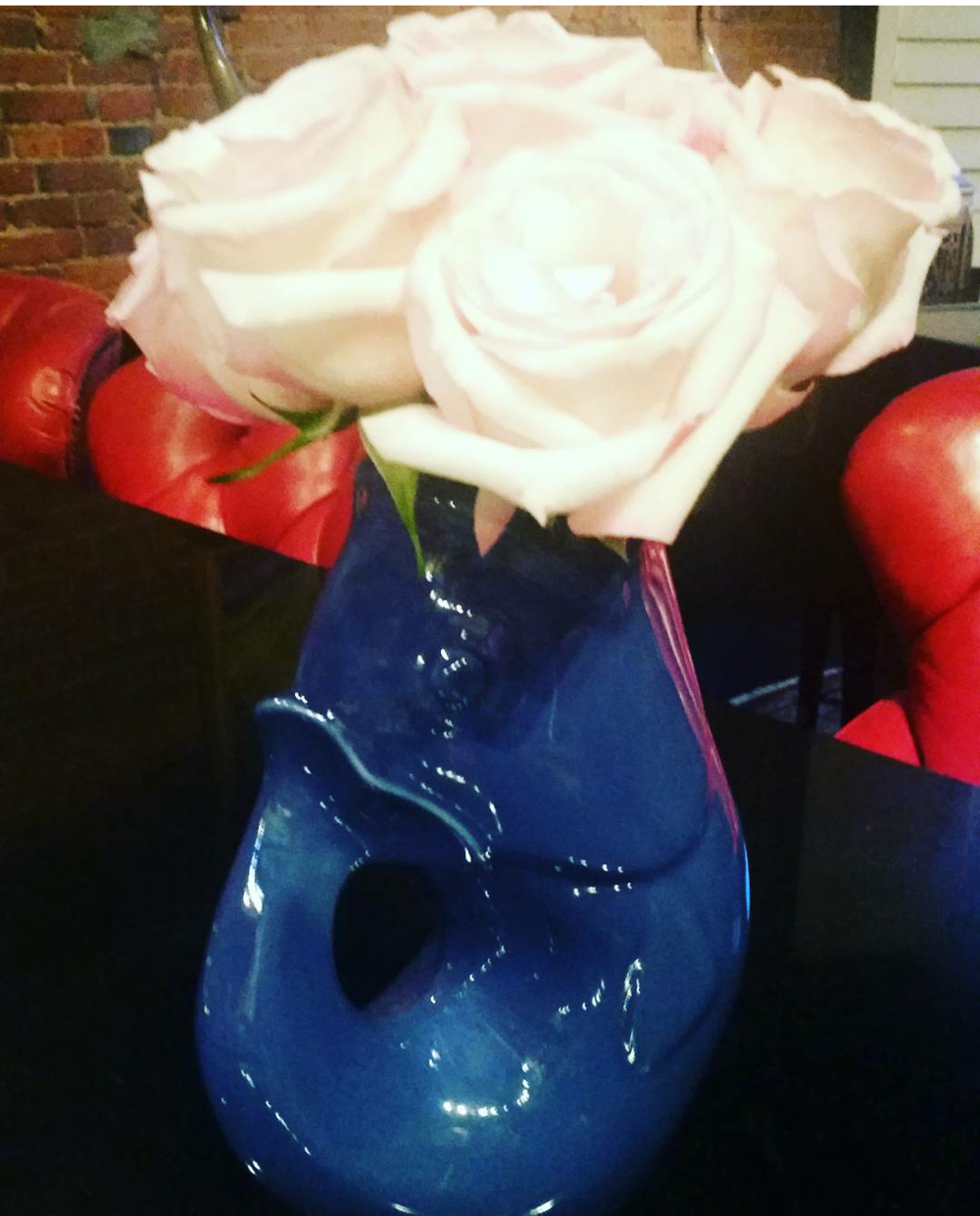 Flowers in a blue koi fishwater pitcher vase