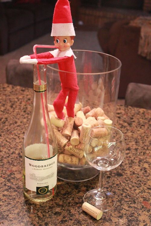 Elf on the Shelf drinking wine from straw