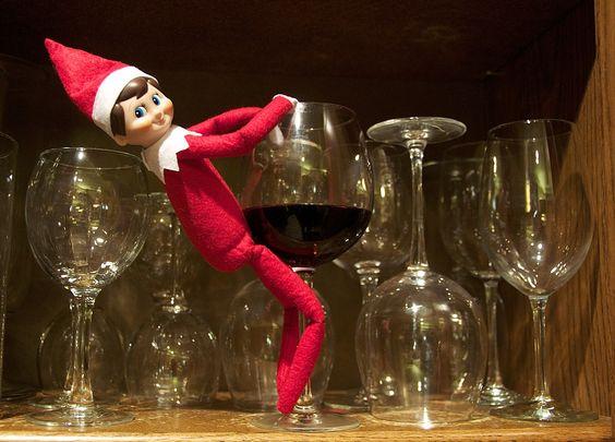 Elf on the Shelf dancing on wine glass