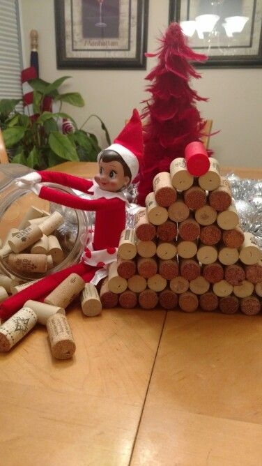 Elf on the Shelf playing in wine corks