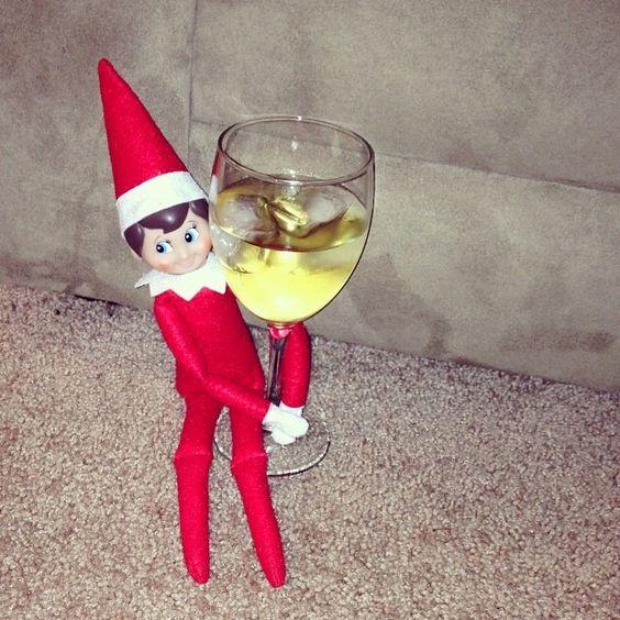 Elf on the Shelf enjoying a glass of white wine