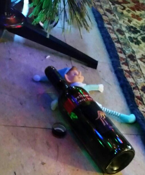 Elf on the Shelf passed out from drinking too much wine